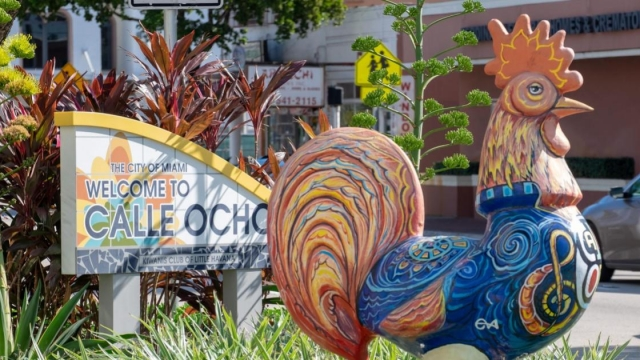 Decorative rooster statues painted with colourful designs welcome visitors to Calle Ocho in the heart of Little Havana in Miami