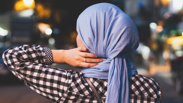 A stock photo of a Muslim woman wearing a headscarf (Photo: Artur Aldyrkhanov on Unsplash)