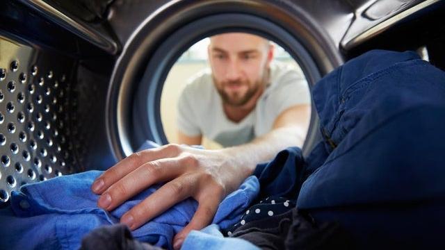Article thumbnail: Person reaching into washing machine