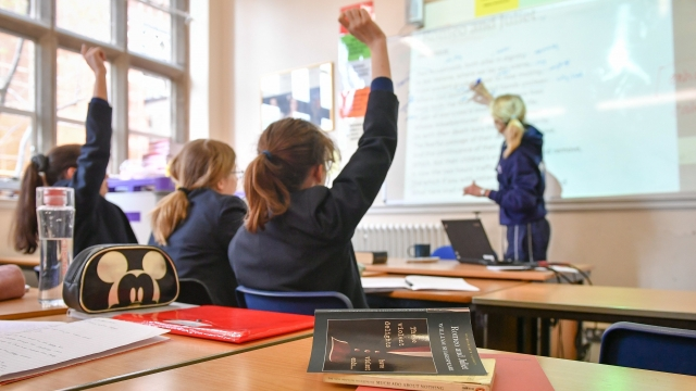 Teachers praising pupils is more effective in improving behaviour than telling them off for disruption, a US study suggests