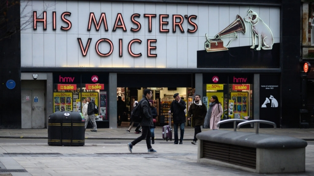 Article thumbnail: Shoppers pass by the original branch of the HMV chain of music retailers (Photo: Getty)
