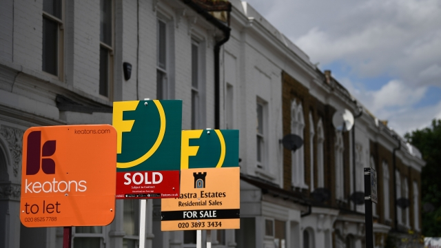 Estate and rental agents' boards are pictured on a residential street in Hackney. (Photo: Daniel Leal-Olivas/ AFP via Getty Images)