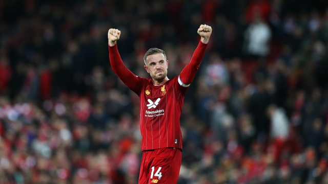 LIVERPOOL, ENGLAND - OCTOBER 27: Jordan Henderson of Liverpool celebrates victory after the Premier League match between Liverpool FC and Tottenham Hotspur at Anfield on October 27, 2019 in Liverpool, United Kingdom. (Photo by Jan Kruger/Getty Images)