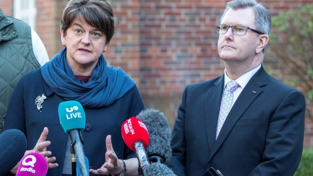 The DUP, pictured Arlene Foster with Jeffrey Donaldson, is heavily opposed to the Prime Minister's exit deal as it will see the province remain aligned to EU rules and regulations