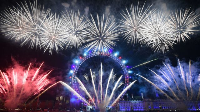 Fireworks explode around the London Eye during New Year celebrations in central London (Photo: Getty)