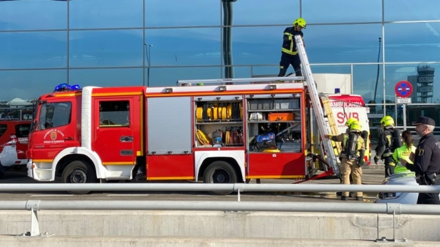 irefighters work at Alicante-Elche airport on January 15, 2020 in Alicante after a fire erupted in the terminal