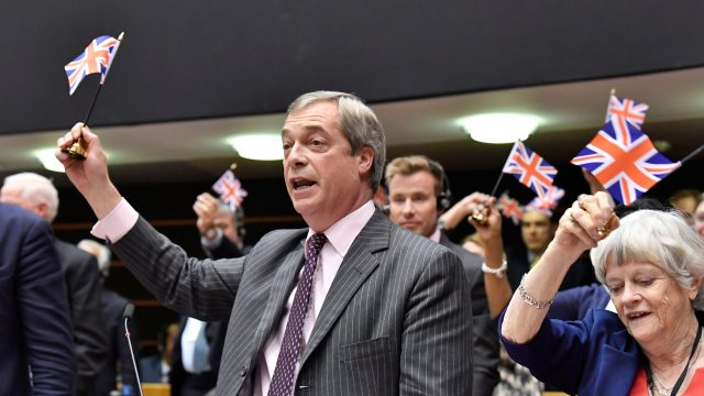 They certainly won't miss Nigel Farage, pictured with Ann Widdecombe, who marked his final day by waving British flags