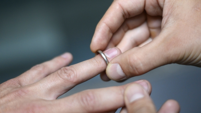 Article thumbnail: Gay men account for 44 per cent of same-sex marriages in the latest data, but make up only 26 per cent of divorcees (Photo: Kenzo/AFP/Getty Images)