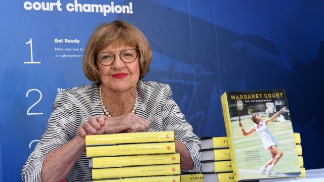 Margaret Court, the former world No.1 and winner of 24 Grand Slam titles poses with her autobiography during day ten of the 2017 Australian Open at Melbourne Park on January 25, 2017 in Melbourne, Australia.