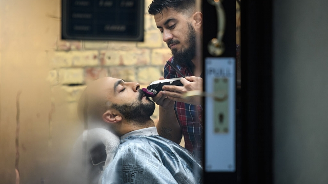 A city worker has a shave at a traditional Turkish barbers in London's Square Mile. These salons are booming across the UK (Photo by Leon Neal/Getty Images)