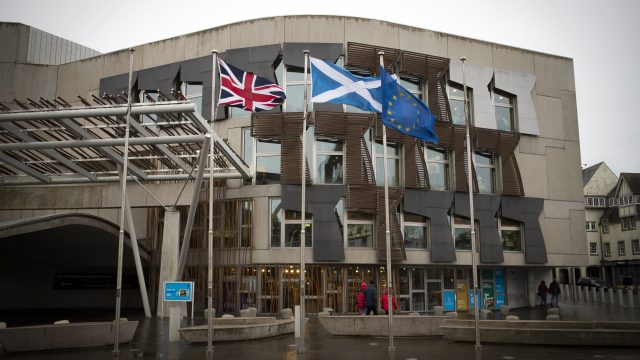 The Union flag, Saltire and EU flag fly outside the Scottish Parliament in Edinburgh
