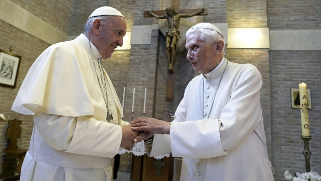 Pope Francis, left, and Pope Benedict XVI, meet each other on the occasion of the elevation of five new cardinals at the Vatican. Retired Pope Benedict XVI has broken his silence to reaffirm the value of priestly celibacy, co-authoring a bombshell book at the precise moment that Pope Francis is weighing whether to allow married men to be ordained to address the Catholic priest shortage. (L'Osservatore Romano/Pool photo via AP, File)