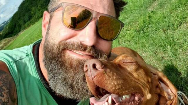 Rob Osman, the founder of Dudes and Dogs with his Hungarian Vizsla, Mali