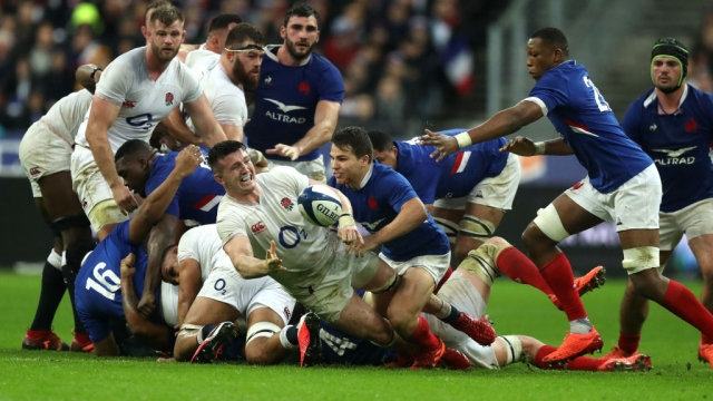 Tom Curry makes the England back-row's only offload of the match under pressure from the French defence (Getty Images)