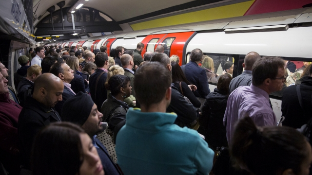 Commuters travel on the Northern Line of the London Underground which is running a limited service due to industrial action