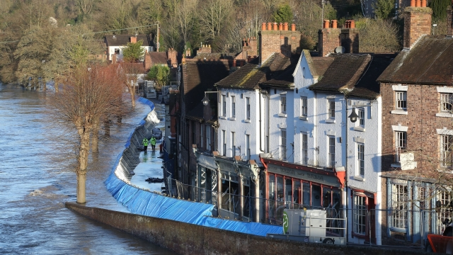 Article thumbnail: Temporary flood barriers in Ironbridge, Shropshire today, as the River Severn remains high, with warnings of further flooding across the UK