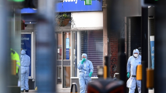 Police forensic officers work outside of a Boots store on Streatham High Road after the knife attack