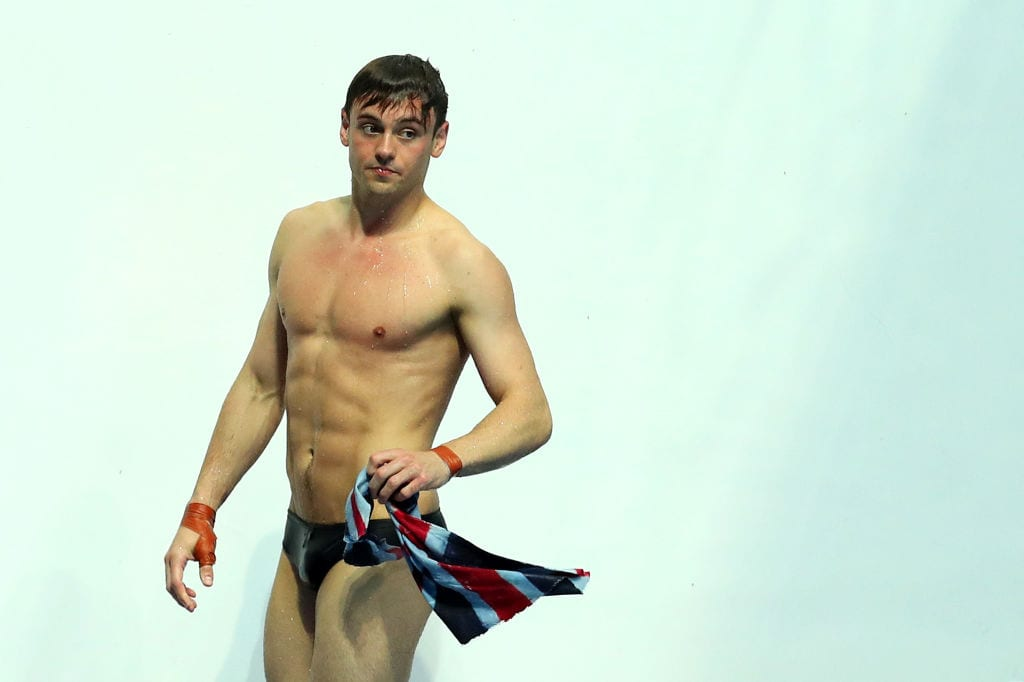 Article thumbnail: Tom Daley competes in Gwangju, South Korea in 2019. Despite his hopes for Tokyo 2020, he says postponing the Olympics is the right thing to do