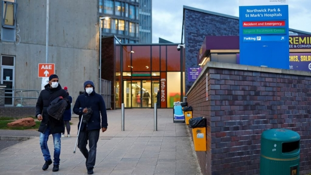 People wearing masks as a precautionary measure against covid-19, leave Northwick Park Hospital in London on 20 March (Photo: Getty)