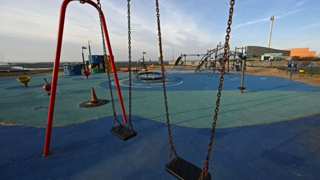 A deserted playground in Rhyl, north Wales, as new restrictions are imposed