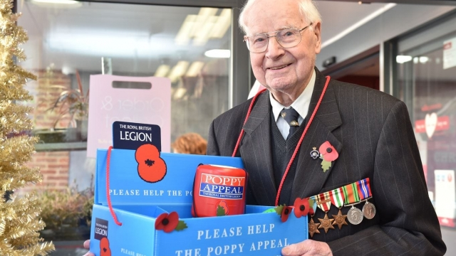 Walter Randall selling poppies when he was 101