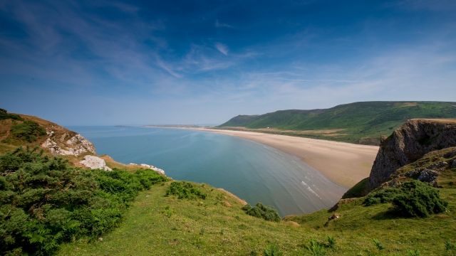Across the Gower, at its westernmost extremity, lies Rhossili Bay and three miles of golden beach