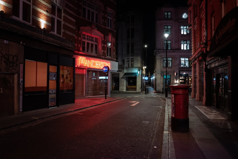 Empty streets and boarded up shops in Soho's Brewer Street on Friday evening (Photo by Leon Neal/Getty Images)