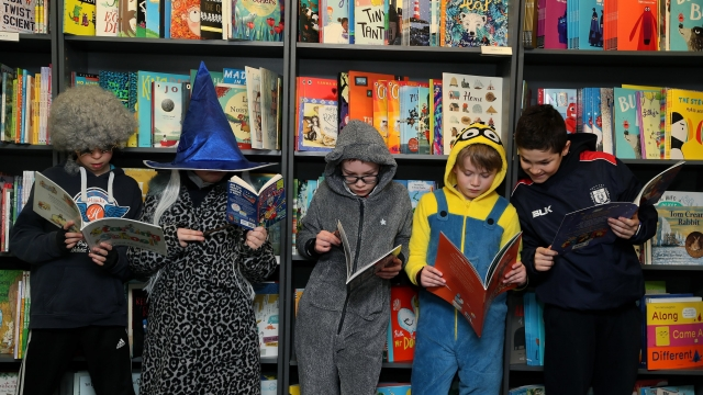 Children from Catholic University School (from left) Michael McGowan (11), Benn Cunningham (10), Conn O'Riordan (11) Dylan Ryan (9), and William Loomes (11), celebrating World Book Day at Hodges Figgis in Dublin (Photo: PA)