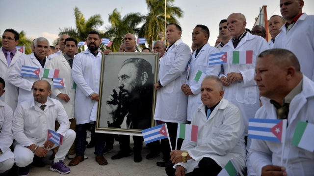Doctors and nurses in Havana on 21 March before travelling to Italy to help in the fight against the coronavirus pandemic