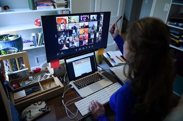 Pupils across the UK turned to video conferencing apps to complete their schoolwork during the pandemic (Photo: Oliver Dougliery/AFP)