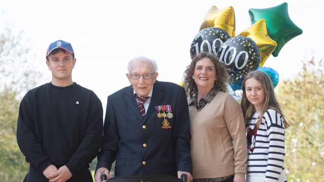 99-year-old war veteran Captain Tom Moore, with (left to right) grandson Benji, daughter Hannah Ingram-Moore and granddaughter Georgia