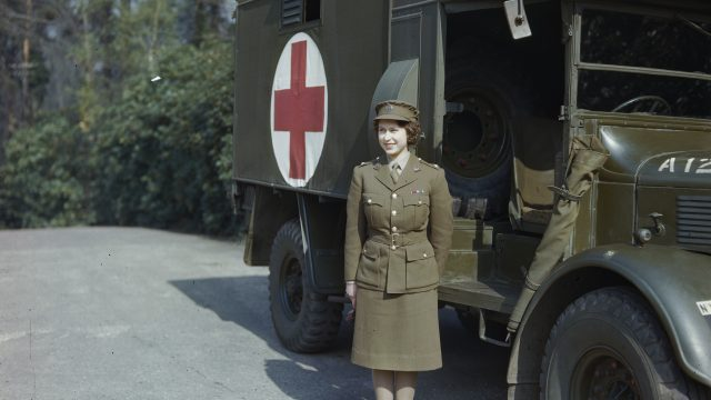 Princess Elizabeth in her Auxiliary Territorial Service uniform in front of an Army ambulance during the Second World War (Photo: Topical Press Agency/Getty Images)