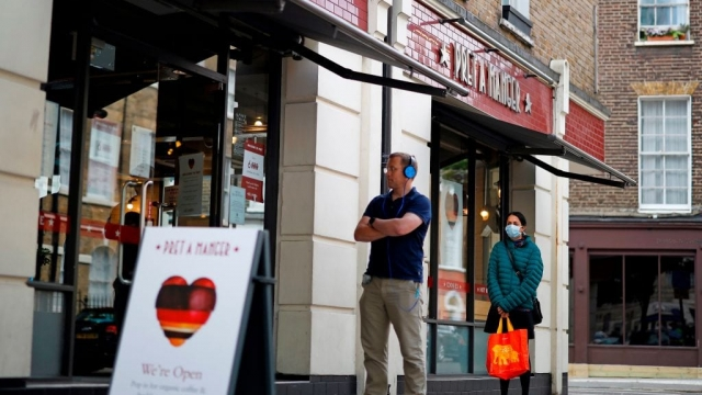 Customers adhere to social distancing as they queue to enter a recently re-opened Pret-A-Manger shop which had originally closed-down due to the Covid-19 pandemic, in London as life continues during the nationwide lockdown.