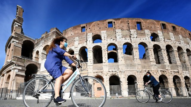 Woman cycling Rome