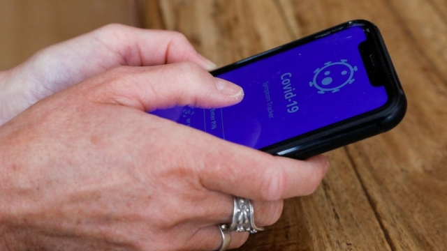 Illustration picture shows a smartphone with a corona virus contact tracing app, in Brussels, Thursday 28 May 2020. It is not yet clear which app or apps will be selected by the government in the exit strategy from the corona virus crisis. BELGA PHOTO THIERRY ROGE (Photo by THIERRY ROGE/BELGA MAG/AFP via Getty Images)