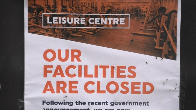 A closed sign is seen in the window of The Cardiff International Swimming Pool and Leisure centre