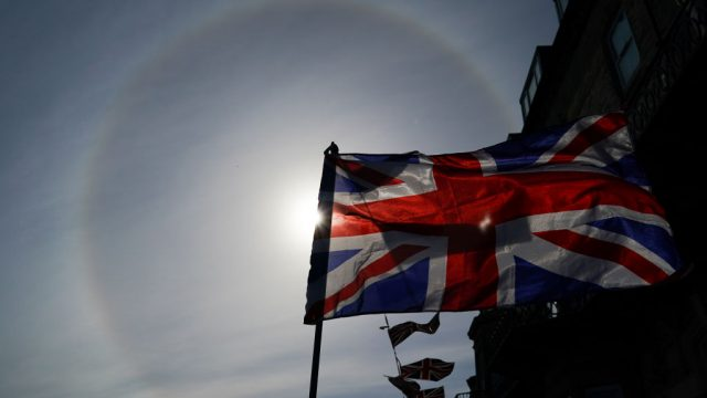 A sun halo shines in the sky behind a Union flag during celebrations for the 75th anniversary of VE Day on 8 May. (Photo by Ian Forsyth/Getty Images)