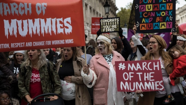Women protest outside Downing Street as they join a demonstration demanding rights for working mothers in 2017