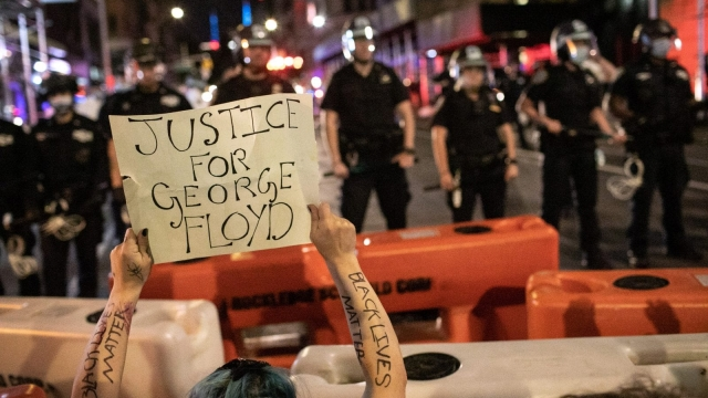 Protesters kneel in front of New York City Police during a march to honor George Floyd near Union Square on May 31, 2020 in New York City. (Photo: Getty Images)